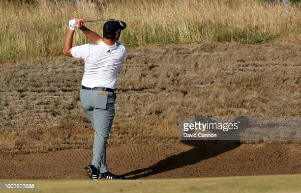 Jon Rahm of Spain plays his second shot on the 14th hole during the second round of the 147th Open Championship at Carnoustie Golf Club on July 20,...