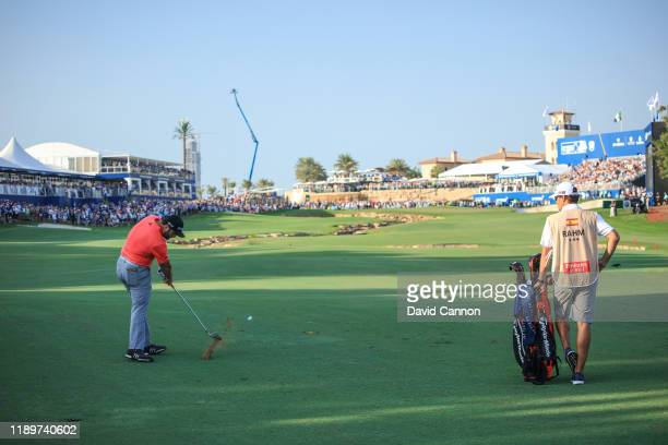 Jon Rahm of Spain plays his second shot on the 18th hole during the final round of the DP World Tour Championship Dubai on the Earth Course at the...