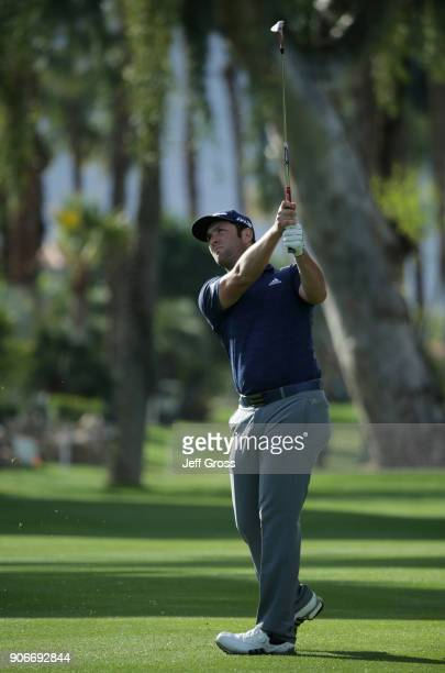 Jon Rahm of Spain plays his second shot on the eighth hole during the first round of the CareerBuilder Challenge at La Quinta Country Club on January...