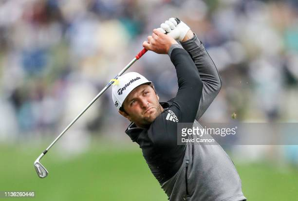 Jon Rahm of Spain plays his second shot on the par 4 18th hole during the third round of the 2019 Players Championship held on the Stadium Course at...
