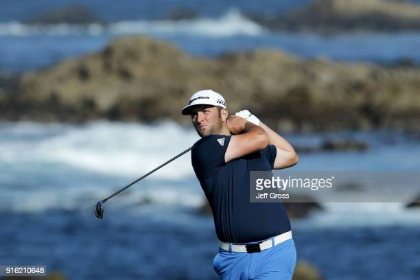 Jon Rahm of Spain plays his shot from the 13th tee during Round One of the ATT Pebble Beach ProAm at Monterey Peninsula Country Club on February 8...