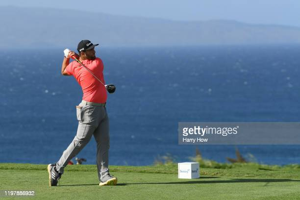 Jon Rahm of Spain plays his shot from the 13th tee during the final round of the Sentry Tournament Of Champions at the Kapalua Plantation Course on...