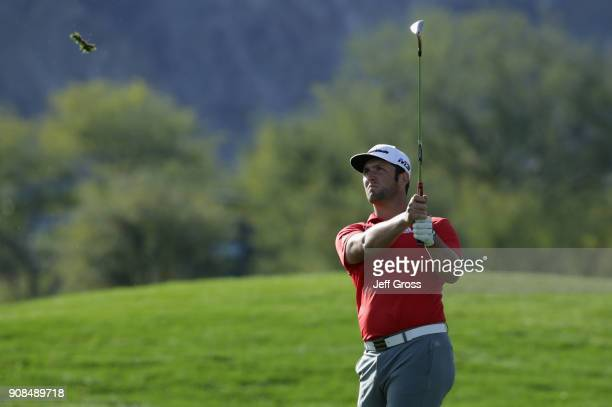 Jon Rahm of Spain plays his shot on the 14th hole during the final round of the CareerBuilder Challenge at the TPC Stadium Course at PGA West on...