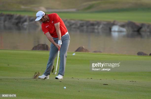 Jon Rahm of Spain plays his shot on the third hole of a sudden death playoff during the final round of the CareerBuilder Challenge at the TPC Stadium...