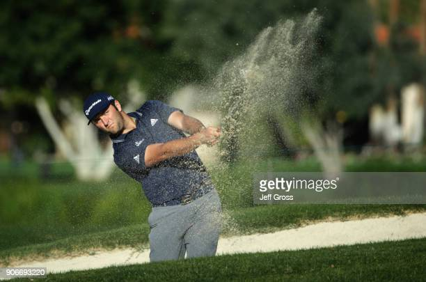 Jon Rahm of Spain plays his shot out of the fairway bunker on the first hole during the first round of the CareerBuilder Challenge at La Quinta...