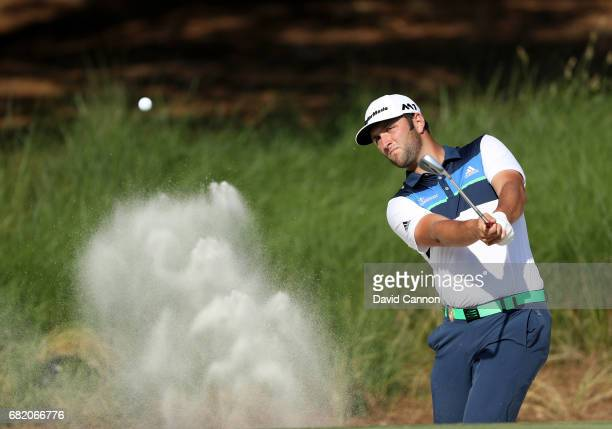 Jon Rahm of Spain plays his third shot at the par 4 14th hole during the first round of THE PLAYERS Championship on the Stadium Course at TPC...