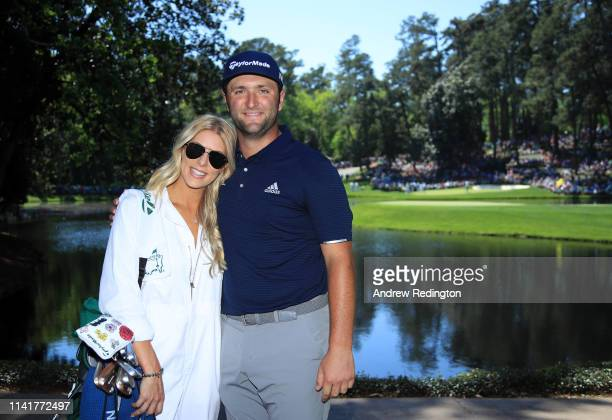 Jon Rahm of Spain poses with fiancee Kelley Cahill during the Par 3 Contest prior to the Masters at Augusta National Golf Club on April 10 2019 in...