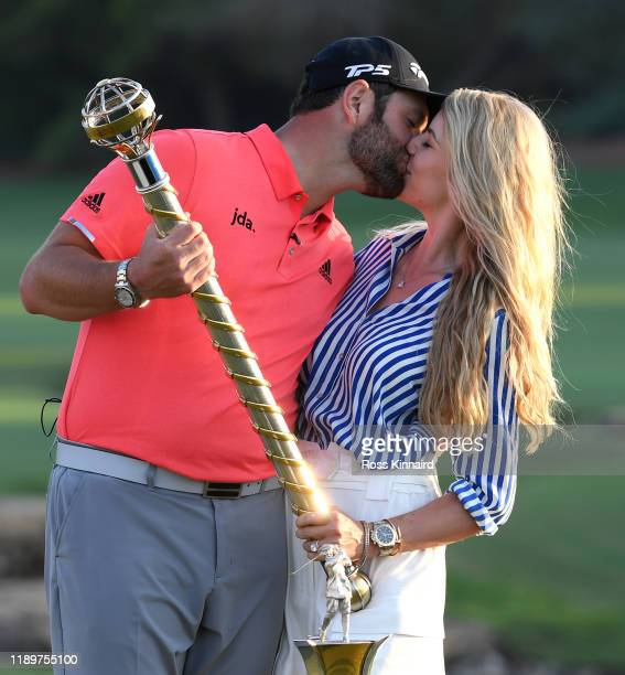 Jon Rahm of Spain poses with his fiance Kelley Cahill and the DP World Tour Championship trophy following his victory during Day Four of the DP World...