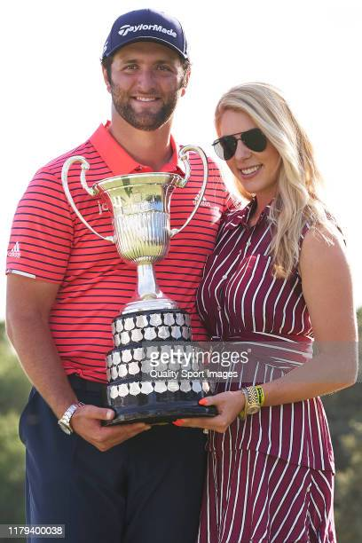 Jon Rahm of Spain poses with his Girlfriend Kelley Cahill after winning the Open de España during Day 4 of the Open de Espana at Club de Campo Villa...