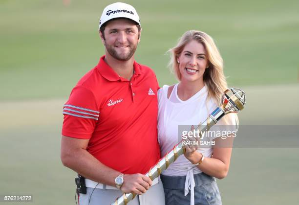 Jon Rahm of Spain poses with his girlfriend Kelley Cahill following his victory at the end of the final round of the DP World Tour Golf Championship...