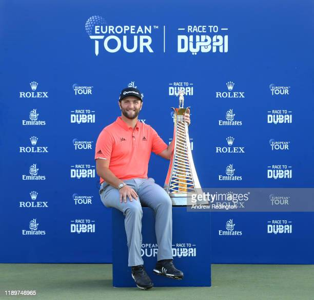 Jon Rahm of Spain poses with the Race to Dubai trophy following his victory during Day Four of the DP World Tour Championship Dubai at Jumerirah Golf...