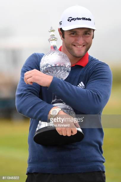 Jon Rahm of Spain poses with the trophy after his victory during the final round of the Dubai Duty Free Irish Open at Portstewart Golf Club on July...