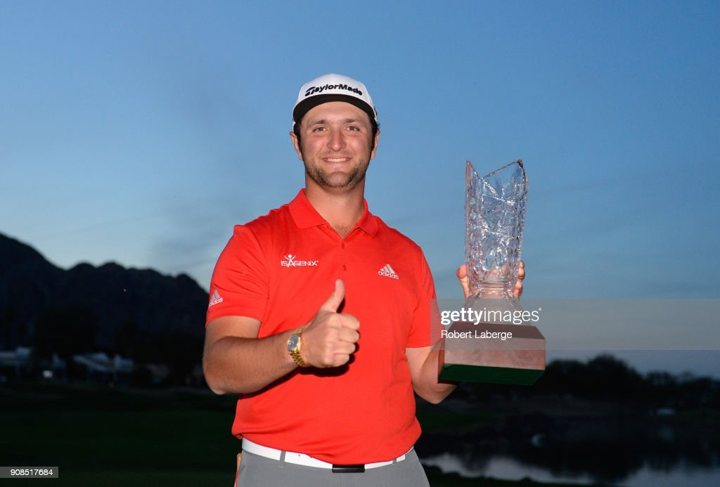Jon Rahm of Spain poses with the trophy after putting in to win on the fourth hole of a sudden death playoff during the final round of the CareerBuilder Challenge at the TPC Stadium Course at PGA West on January 21, 2018 in La Quinta, California.
