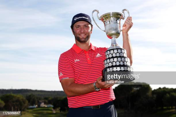 Jon Rahm of Spain poses with the trophy after winning the Open de Espana during Day four of the Open de Espana at Club de Campo Villa de Madrid on...