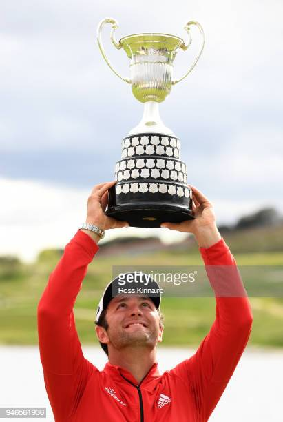 Jon Rahm of Spain poses with the trophy after winning the Open de Espana Day Four of the Open de Espana at Centro Nacional de Golf on April 15 2018...