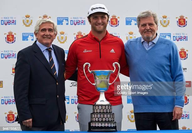 Jon Rahm of Spain poses with the trophy after winning the Open de Espana with Gonzaga Escauriaza and Inigo Mendez de Vigo during day four of Open de...