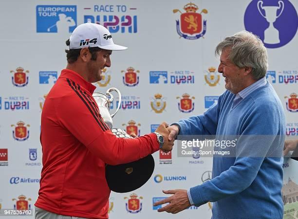 Jon Rahm of Spain poses with the trophy after winning the Open de Espana with Inigo Mendez de Vigo during day four of Open de Espana at Centro...