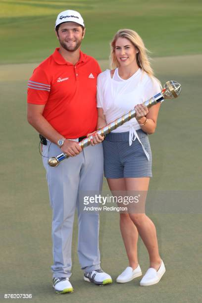 Jon Rahm of Spain poses with the trophy and girlfriend Kelley Cahill following his victory during the final round of the DP World Tour Championship...