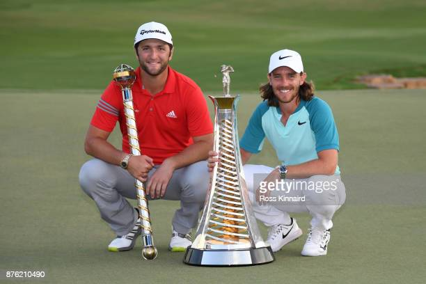 Jon Rahm of Spain poses with the trophy and Tommy Fleetwood of England poses with the Race to Dubai trophy during the final round of the DP World...