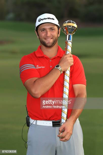 Jon Rahm of Spain poses with the trophy following his victory during the final round of the DP World Tour Championship at Jumeirah Golf Estates on...