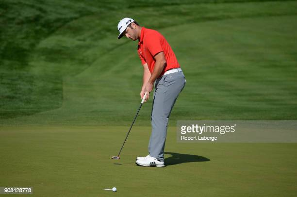 Jon Rahm of Spain putts on the eighth green during the final round of the CareerBuilder Challenge at the TPC Stadium Course at PGA West on January 21...