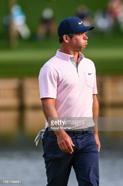 Jon Rahm of Spain reacts as he looks at his ball in the rough on the 16th hole during the third round of THE PLAYERS Championship on the Stadium...