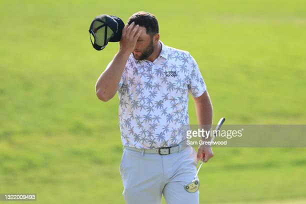 Jon Rahm of Spain reacts as he walks off the 18th green after completing his third round of The Memorial Tournament at Muirfield Village Golf Club on...
