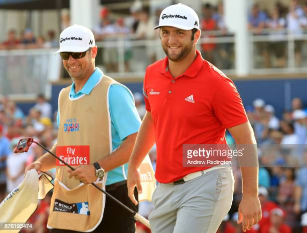 Jon Rahm of Spain reacts on the 18th green with his caddie Adam Hayes during the final round of the DP World Tour Championship at Jumeirah Golf...