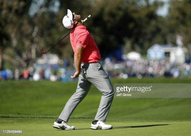 Jon Rahm of Spain reacts to a missed birdie putt on the 10th hole on the South Course during the final round of the the 2019 Farmers Insurance Open...