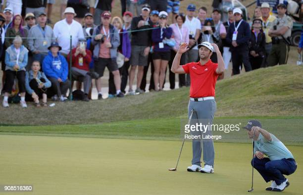 Jon Rahm of Spain reacts to a missed putt on the second playoff hole of a sudden death playoff during the final round of the CareerBuilder Challenge...
