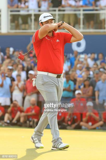 Jon Rahm of Spain reacts to a putt on the 18th green during the final round of the DP World Tour Championship at Jumeirah Golf Estates on November 19...