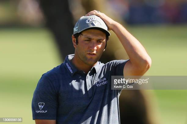 Jon Rahm of Spain reacts to a putt on the ninth green during the first round of THE PLAYERS Championship on THE PLAYERS Stadium Course at TPC...