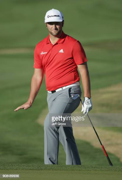 Jon Rahm of Spain reacts to his putt on the 16th hole during the final round of the CareerBuilder Challenge at the TPC Stadium Course at PGA West on...