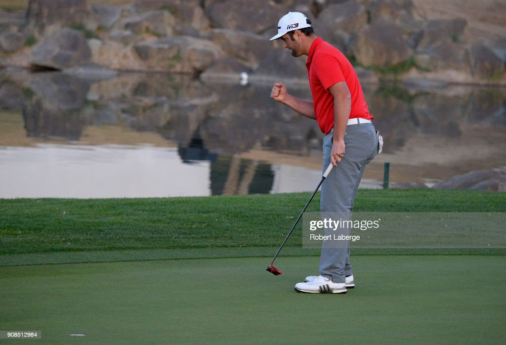 Jon Rahm of Spain reacts to his putt to win on the fourth hole of a sudden death playoff during the final round of the CareerBuilder Challenge at the TPC Stadium Course at PGA West on January 21, 2018 in La Quinta, California.