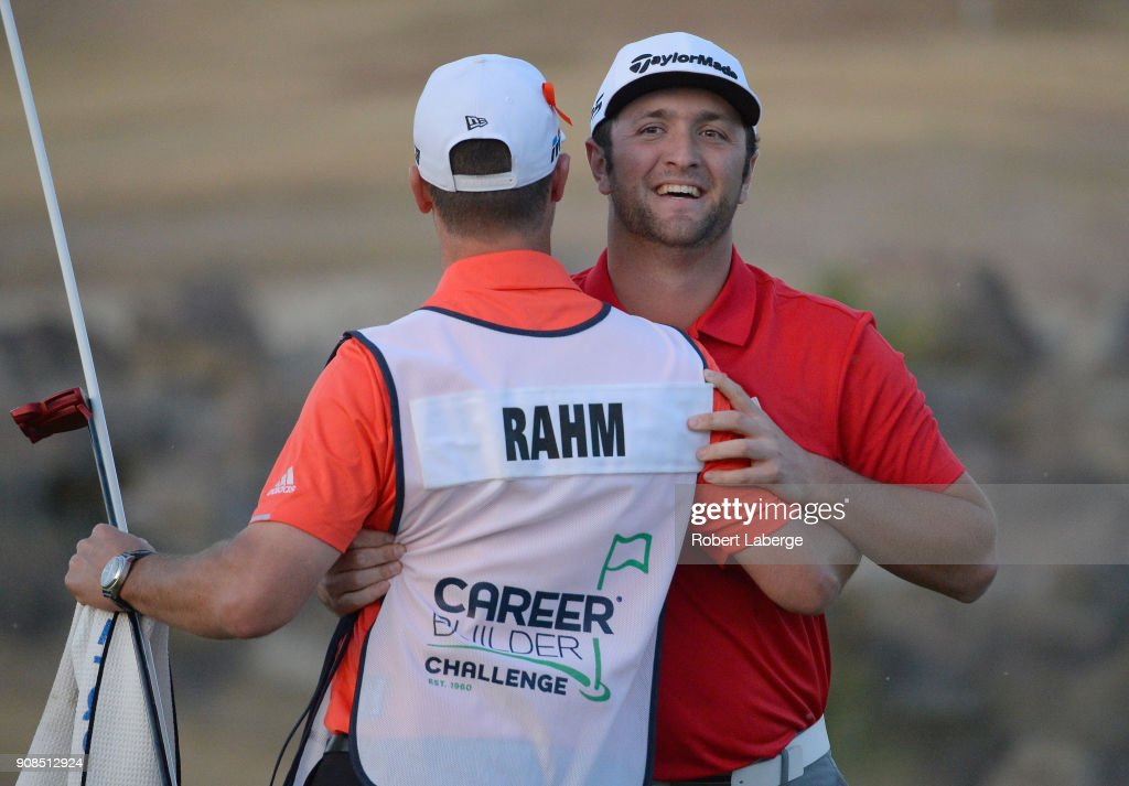 Jon Rahm of Spain reacts to his putt to win with caddie Adam Hayes on the fourth hole of a sudden death playoff during the final round of the CareerBuilder Challenge at the TPC Stadium Course at PGA West on January 21, 2018 in La Quinta, California.