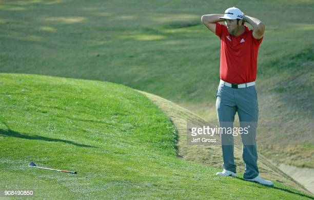 Jon Rahm of Spain reacts to his shot on the 14th hole during the final round of the CareerBuilder Challenge at the TPC Stadium Course at PGA West on...