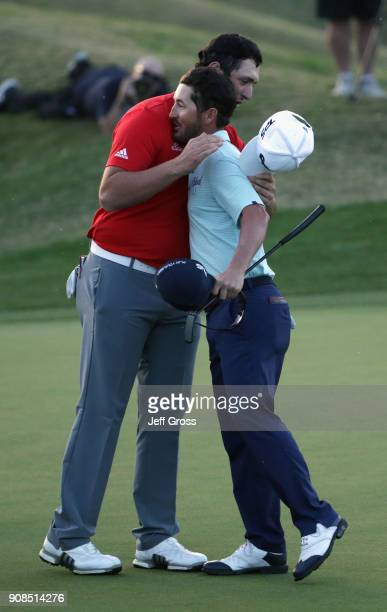 Jon Rahm of Spain shakes hands with Andrew Landry after he putt in to win on the fourth hole of a sudden death playoff during the final round of the...