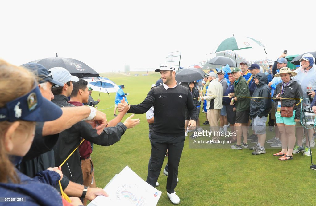 Jon Rahm of Spain shakes hands with fans during a practice round prior to the 2018 U.S. Open at Shinnecock Hills Golf Club on June 13, 2018 in Southampton, New York.