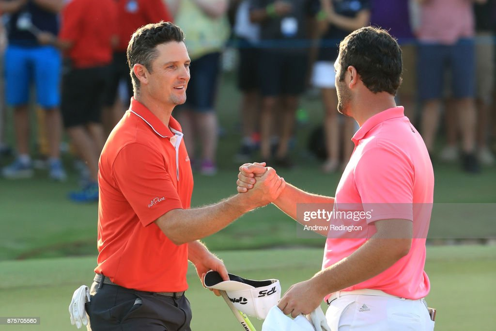 Jon Rahm of Spain shakes hands with Justin Rose of England on the 18th green during the third round of the DP World Tour Championship at Jumeirah Golf Estates on November 18, 2017 in Dubai, United Arab Emirates.