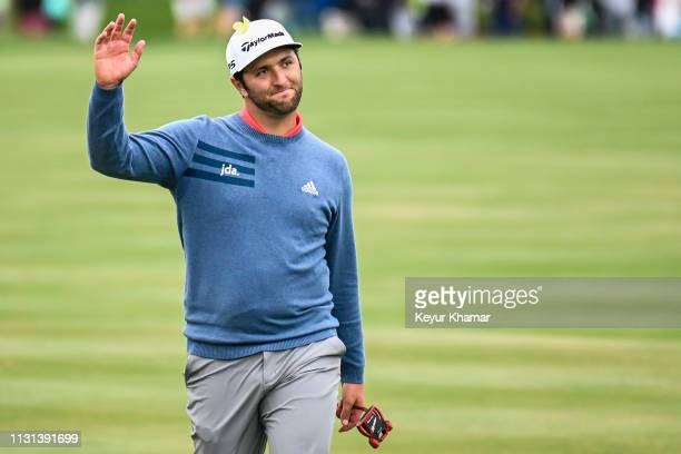 Jon Rahm of Spain smiles and waves at fans as he walks to the 18th hole green during the final round of THE PLAYERS Championship on the Stadium...