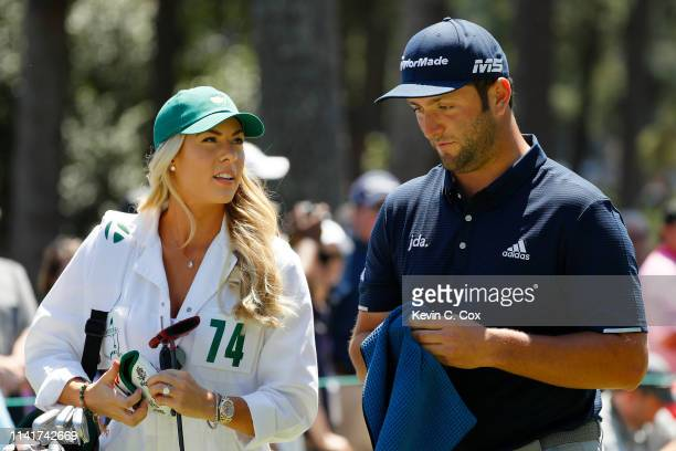 Jon Rahm of Spain stands with fiancee Kelley Cahill during the Par 3 Contest prior to the Masters at Augusta National Golf Club on April 10 2019 in...