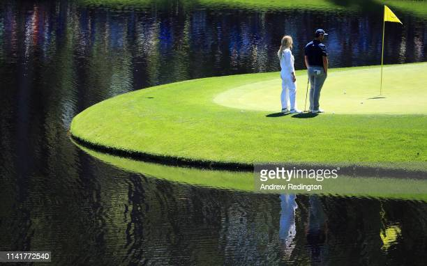Jon Rahm of Spain stands with girlfriend Kelley Cahill during the Par 3 Contest prior to the Masters at Augusta National Golf Club on April 10 2019...