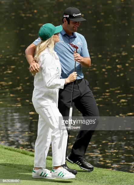 Jon Rahm of Spain talks with his wife Kelley Cahill during the Par 3 Contest prior to the start of the 2018 Masters Tournament at Augusta National...