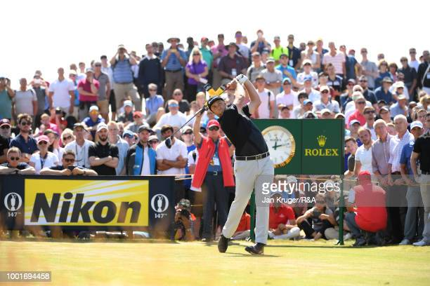 Jon Rahm of Spain tees off at the 9th hole during round one of the 147th Open Championship at Carnoustie Golf Club on July 19 2018 in Carnoustie...