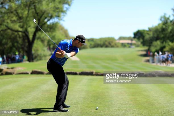 Jon Rahm of Spain tees off on the 10th hole of his match during round five of the World Golf ChampionshipsDell Technologies Match Play at the Austin...