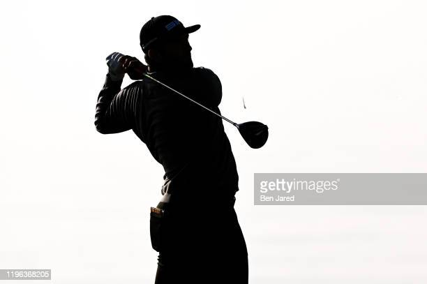 Jon Rahm of Spain tees off on the 17th tee during the third round of the Farmers Insurance Open at Torrey Pines South on January 25, 2020 in San...