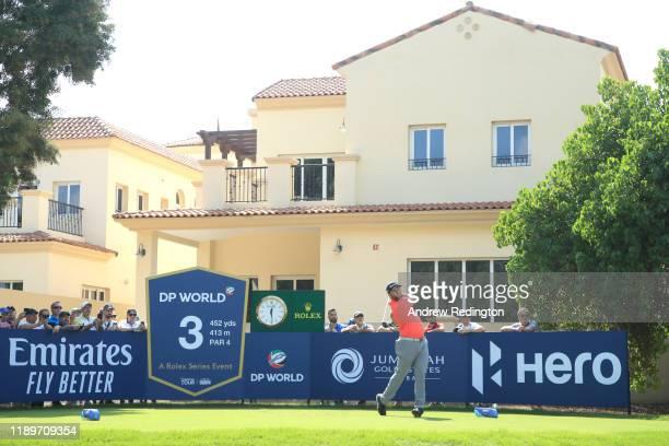 Jon Rahm of Spain tees off on the third during Day Four of the DP World Tour Championship Dubai at Jumerirah Golf Estates on November 24, 2019 in...