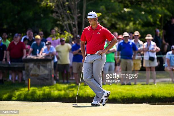 Jon Rahm of Spain waits to putt on the sixth hole green during the final round of the Quicken Loans National at Congressional Country Club on June 26...