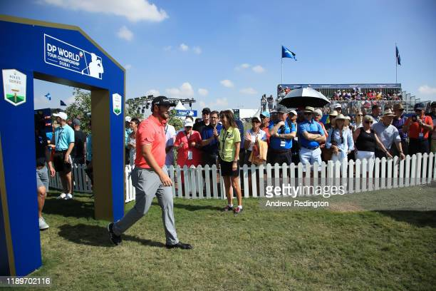 Jon Rahm of Spain walks onto the first tee during Day Four of the DP World Tour Championship Dubai at Jumerirah Golf Estates on November 24, 2019 in...