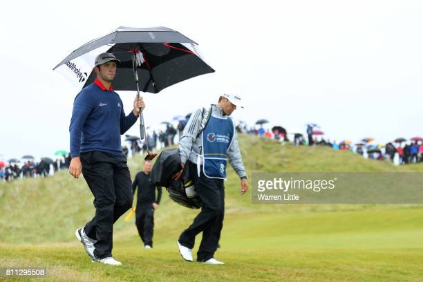 Jon Rahm of Spain walks with his caddie on the 8th hole during the final round of the Dubai Duty Free Irish Open at Portstewart Golf Club on July 9...